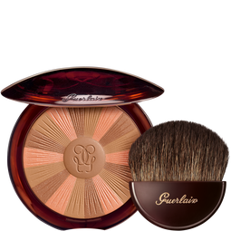 The sun-kissed powder and its brush (See 1/1)