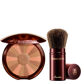 Terracotta Light Radiance powder and its brush